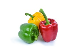 Red bell pepper, green bell pepper, yellow bell peppers (Capsicum annuum) are fruits that belong to the nightshade family. They are related to chili peppers, tomatoes, and breadfruit isolated and path