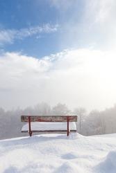 red bench empty desolate winter landscape