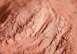 Red bentonite clay powder. Natural beauty treatment and spa. Clay texture close up, selective focus.