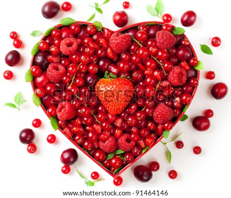 Red berries for Valentine's Day in heart-shaped box