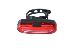 Red bicycle safe rear tail flashing back light warning lamp with flexible rubber mount isolated on white background