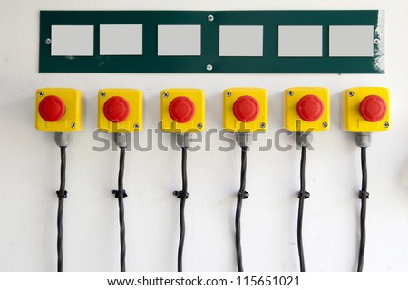 red big buttons on the wall, with cables