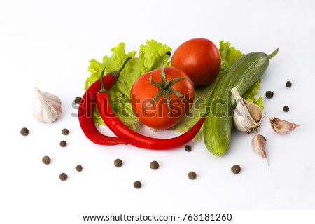 Red bitter pepper cucumber and tomato on a white background.Fresh vegetables on an abel background. - Shutterstock ID 763181260