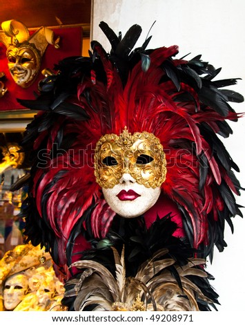 Red, black and golden Venetian mask