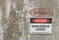 red, black and white Danger, Dangerous Goods warning sign