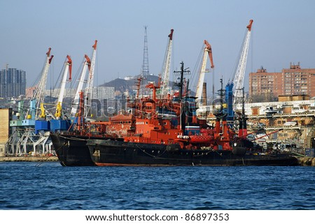 Red-black ships and harbour cranes in Vladivostok, Far East, Russia