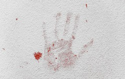 Red blood hand print on wall.