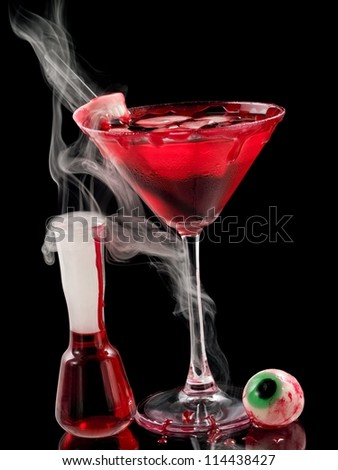 Red bloody halloween cocktail with smoke - stock photo