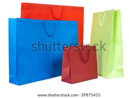 Red, blue and green paper present bags on white background