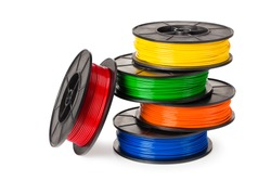 red, blue, green, orange, yellow filament for 3d printer isolated on white background