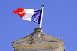 red blue white French flag on city hall