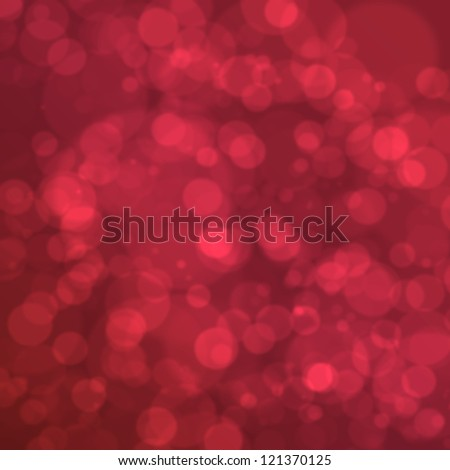 Red blurred round bokeh christmas lights as background