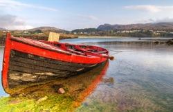 Red boat at Mulranny bay in Irish Co. Mayo - HDR
