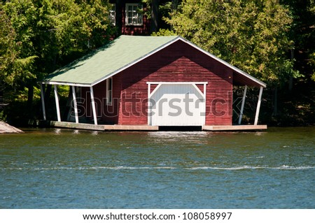 Red boathouse with a covered dock