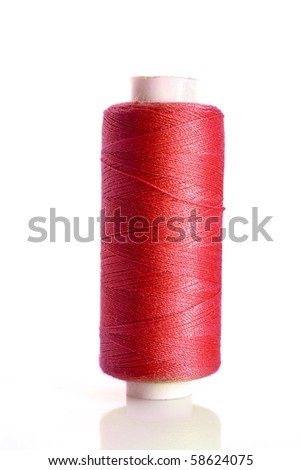 red bobbin thread isolated on white