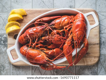Red boiled crayfish with lemon on a cutting board. ストックフォト ©
