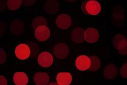 Red bokeh, black background