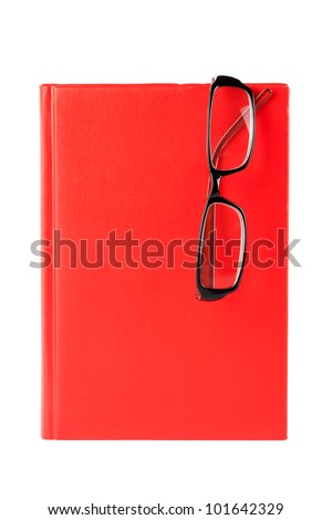 Red book and glasses  on a white background with blank space for your text