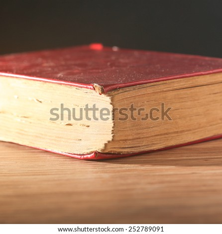 Red book on color background, education