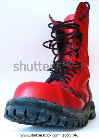red boot on white - Shutterstock ID 1055946