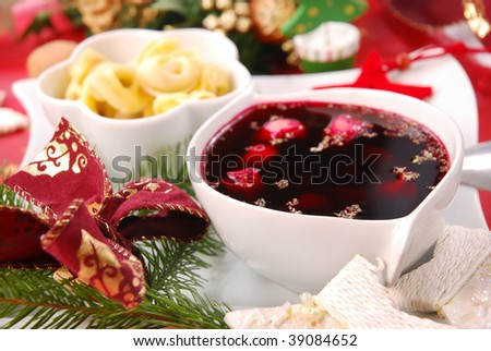 red borscht with mushroom ravioli as traditional christmas eve soup - stock photo