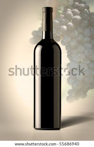 Red bottle of Wine with grapes in the background