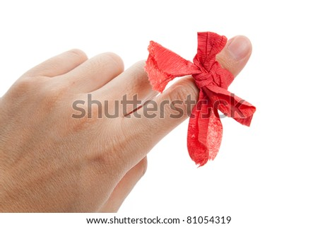 Red bow on finger close up