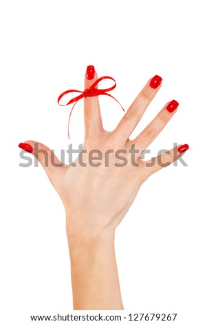 Red bow on finger, concepts sclerosis - stock photo