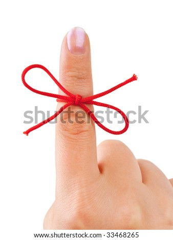 Red bow on finger isolated on white background