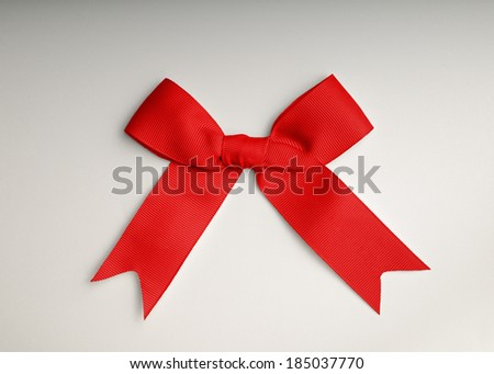 red bow on the table with gradient background