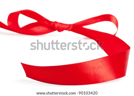 Red bow, red silk ribbon over white background