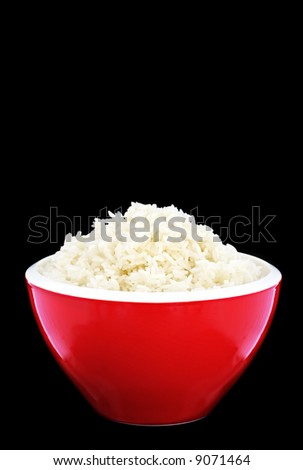 Red bowl of basmati rice, perfectly cooked. Black background.
