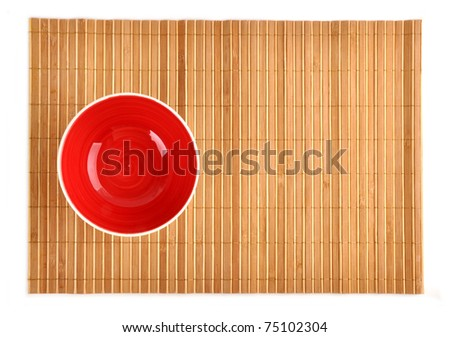 Red bowl on bamboo