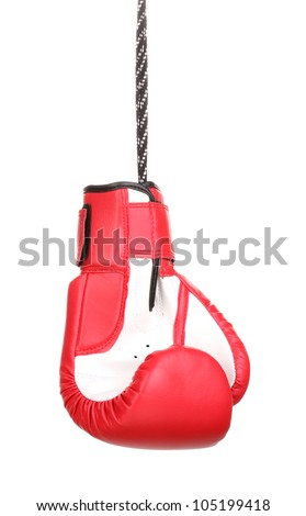 Red boxing glove hanging isolated on white