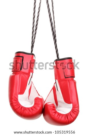 Red boxing gloves hanging isolated on white