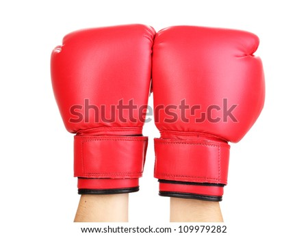 Red boxing gloves on hands isolated on white