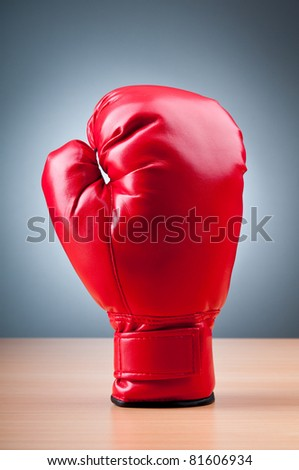 Red boxing gloves on the background