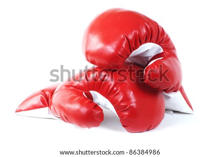Red boxing leather gloves isolated on white.