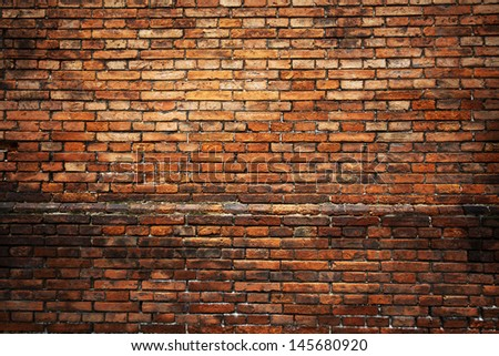 Red brick background: closeup of an old uneven brick wall.