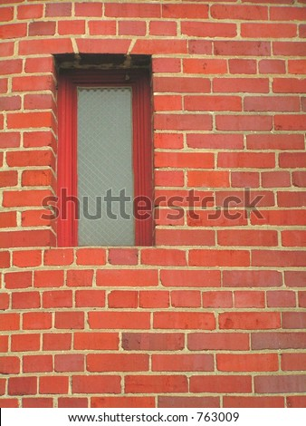 RED BRICK BUILDING WITH RED WINDOW