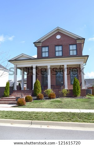 Red Brick Cape Cod Home with Large Front Porch