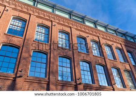 Red brick classic facade of the office building in Moscow