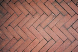 Red Brick Flooring Seamless Pattern. Top View of Red Bricks Paving Stones Footpath on a Sidewalk Outdoors as Brickwork Weaved Texture or Abstract Stone Paver Herringbone Template Background Copyspace