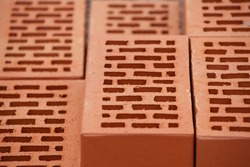 Red brick neatly folded, close up