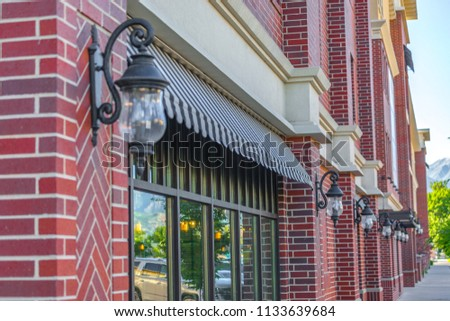 Red brick on store fronts of Provo