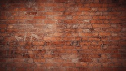 Red brick pattern. Old brick wall with cracks and scratches. Horizontal wide brickwall background. Distressed wall with broken bricks texture. Vintage house facade.