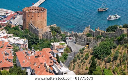 Red brick tower in port of Alanya, Turkey