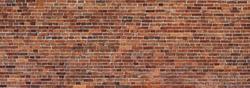 Red Brick wall background. Wide panoramic view of masonry. Grunge red masonry texture.