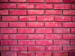 Red brick wall background with vignette effect