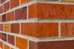 Red brick wall corner on an old building